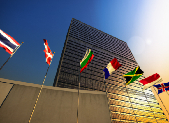nations flags outside skyscraper