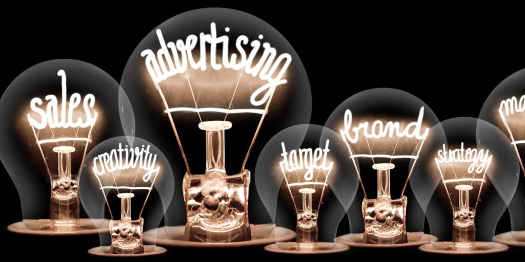 lightbulbs with business buzzwords in filaments